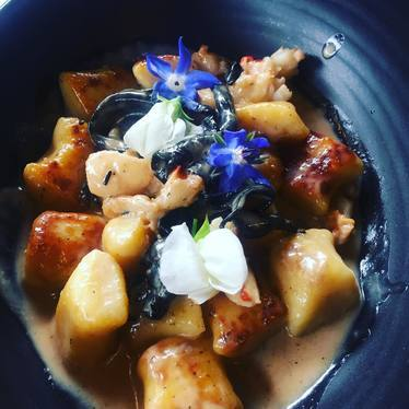 Maine lobster, gnocchi, black chanterelles, edible flowers at Black Cat