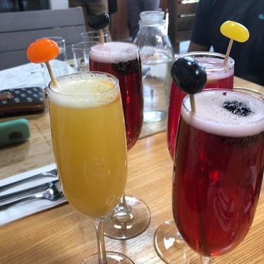 Orange and cranberry mimosas at Primo