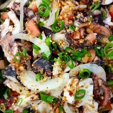 Loko Tako Poke with octopus, limu, seaweed, sesame seeds, green onions, and kukui nuts  at Nico's at Pier 38
