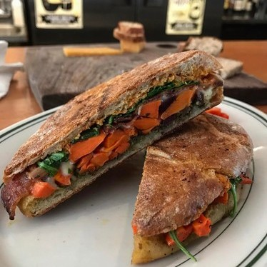 Sandwich with carrots, arugula, pesto, and cheese at Cheese Bar